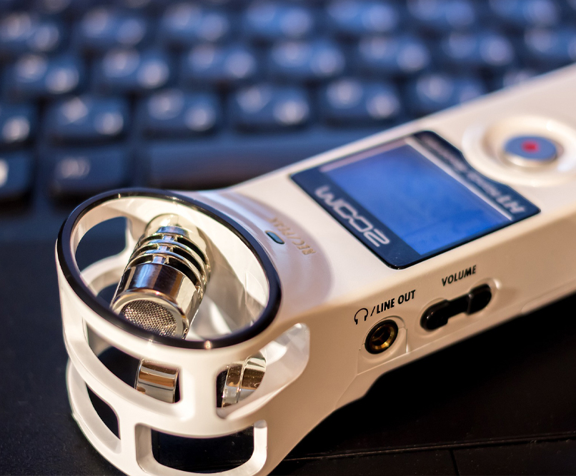 A white handheld audio recorder.