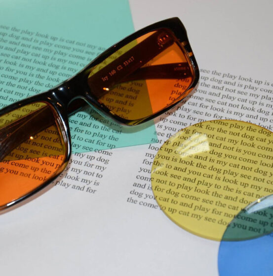 Tinted glasses and coloured overlays